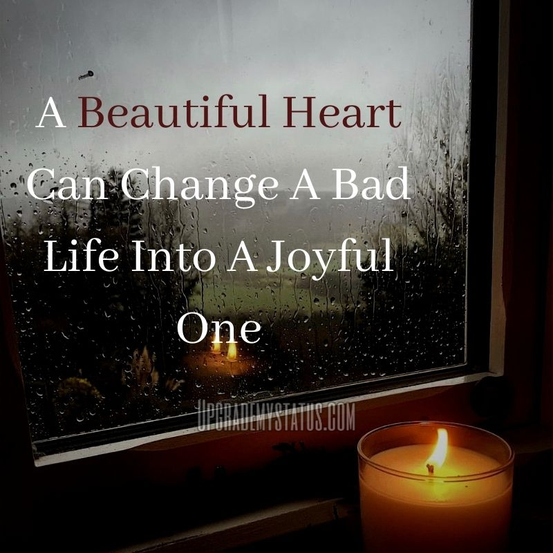 A Candle Is Burning Right In front Of A Window With Life Hard Status