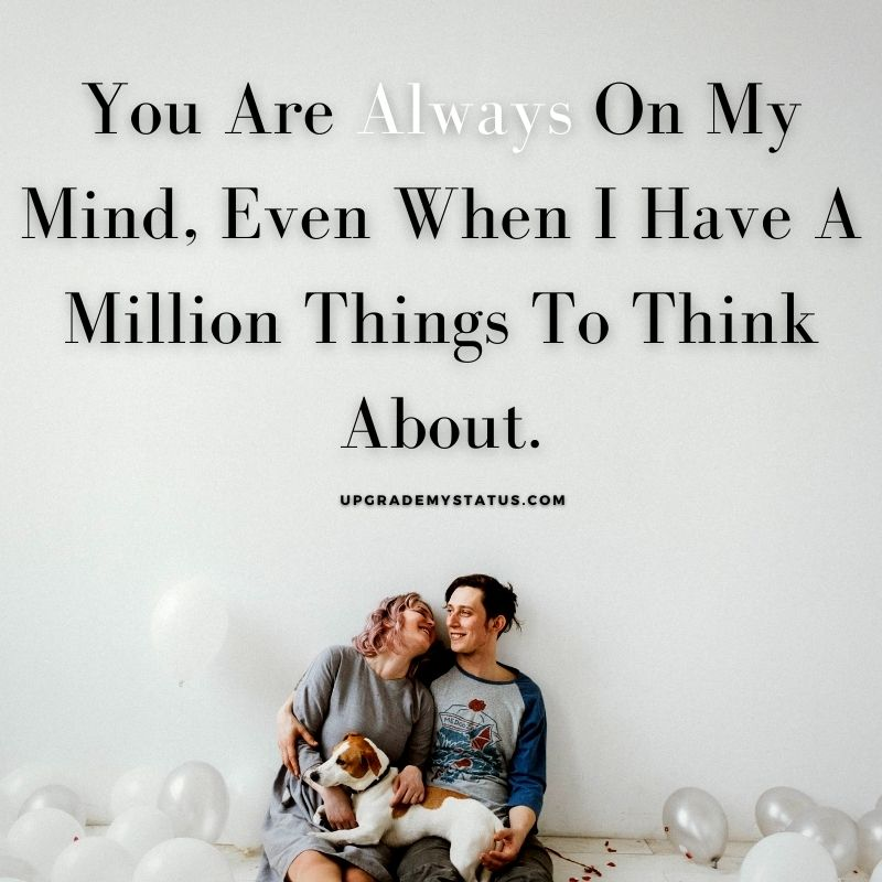 a girl and boy sitting in a room full of balloons with romantic status for WhatsApp written on it.