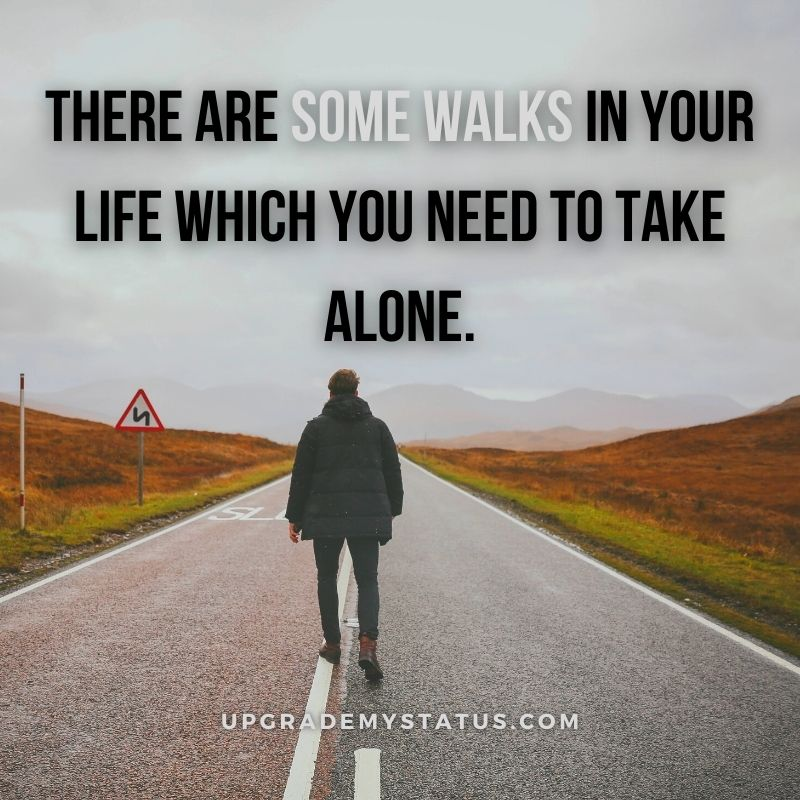 a man is walking on a lonely road with loneliness status written over it