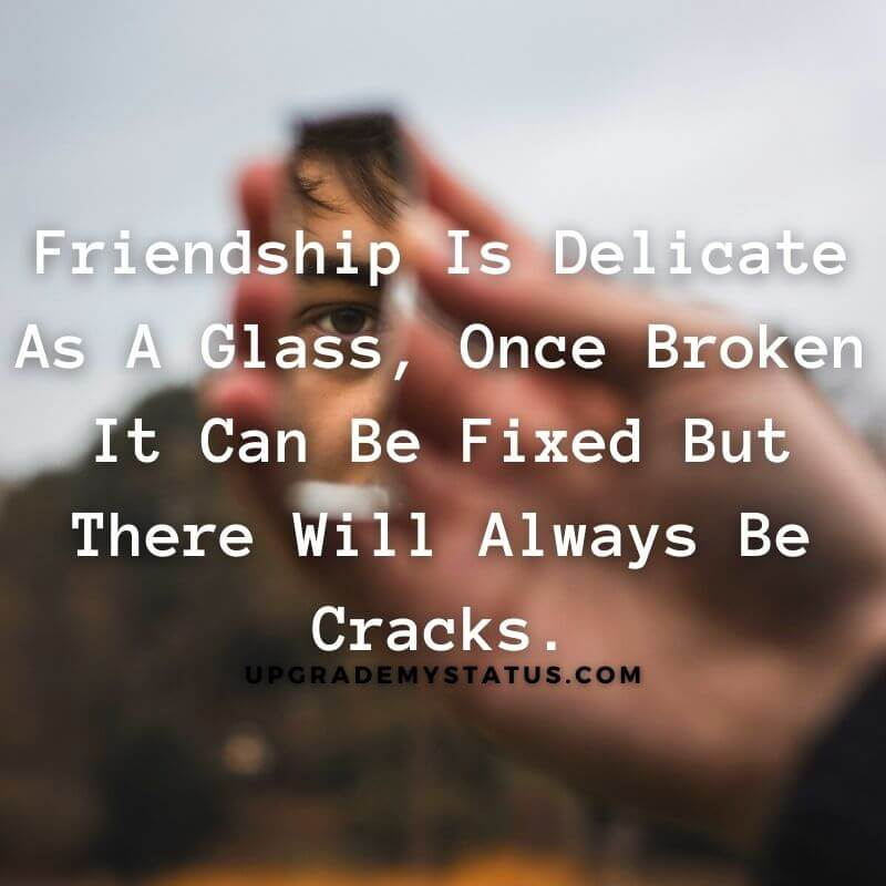 A quote about friendship broke status written over a image showing boys hand holding a piece of mirror