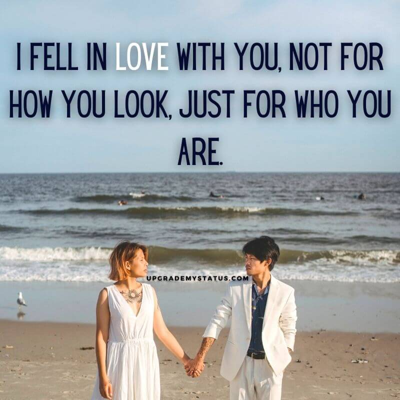 a girl and boy wearing white dresses walking holding hands on a beach over it real love status in english is written