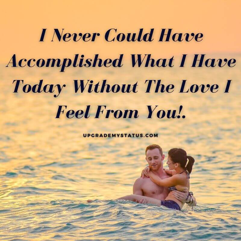image of boy holding girl in his hand in a ocean